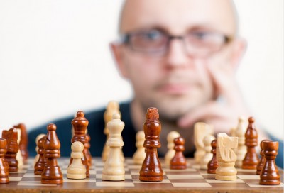 man ponders a chess move